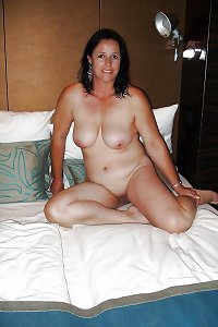 Mature wife on bed